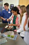 Students were divided into teams of five at each cooking station.