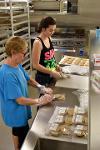 Beth and Maddie package cookies.